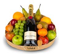 Fruitmand met Moët & Chandon Brut champagne